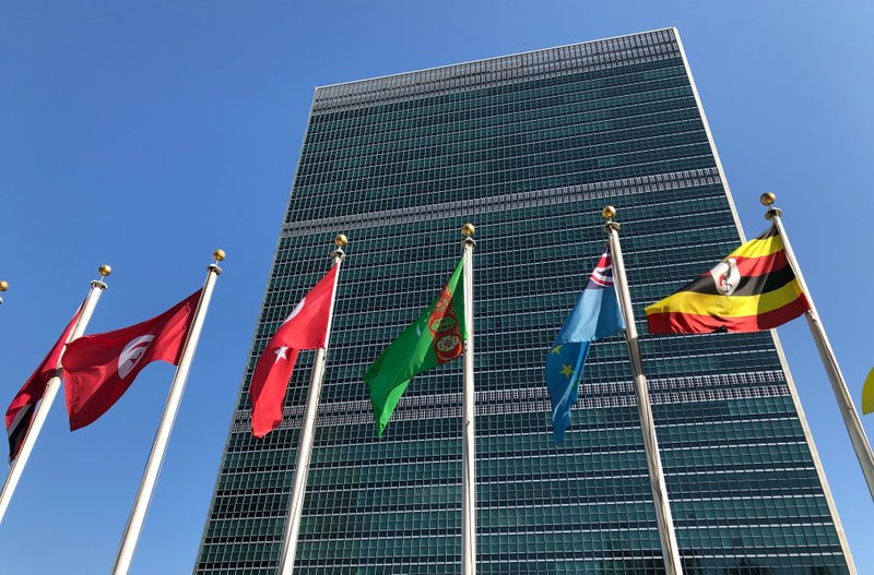 """In this Sept. 28, 2019 file photo, flags fly outside the United Nations headquarters during the 74th session of the United Nations General Assembly. Secretary-General Antonio Guterres says the United Nations is facing its """"worst cash crisis"""" in nearly a decade because 64 of its 193 members have not paid their annual dues, including the United States, which is the U.N.'s largest contributor. Photo: AP"""