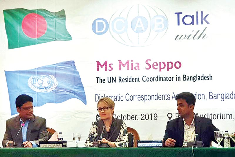United Nations Resident Coordinator (UNRC) Mia Seppo speaks flanked by DCAB President Raheed Ejaz (left) and DCAB General Secretary Nurul Islam Hasib at a DCAB event at BIISS auditorium in Dhaka on Wednesday.