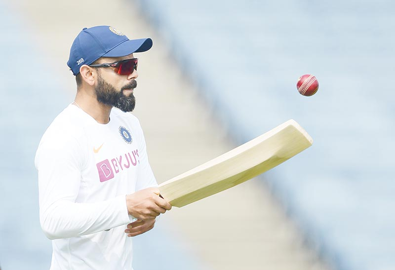 Indian team captain Virat Kohli attend a cricket training session ahead of the second Test match between India and South Africa at the Maharashtra Cricket Association Stadium in Pune on October 9, 2019.photo: AFP