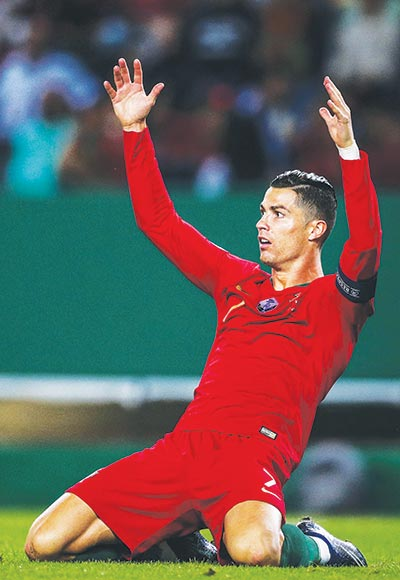 Portugal's forward Cristiano Ronaldo reacts during the Euro 2020 qualifier football match between Portugal and Luxembourg at the Jose Alvalade stadium in Lisbon on October 11, 2019. photo: AFP