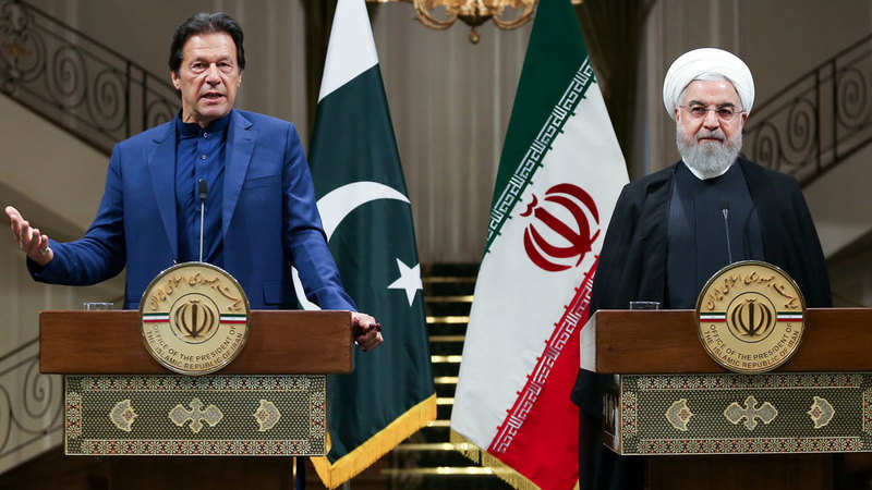 Pakistan Prime Minister Imran Khan speaks during a news conference with Iranian President Hassan Rouhani in Tehran.