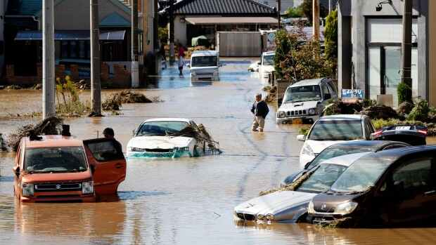 Japan looks for missing after typhoon, warned of mudslides