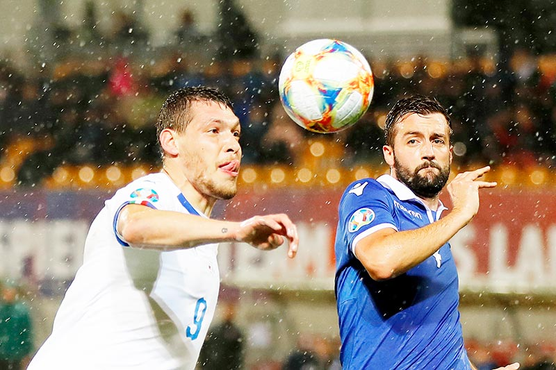Italy's forward Andrea Belotti (L) vies with Liechtenstein's defender Daniel Kaufmann  during the Euro 2020 Group J qualification football match between Liechtenstein and Italy at the Rheinpark Stadium in Vaduz, on October 15, 2019.	photo: AFP