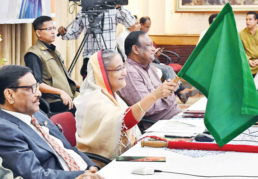 Prime Minister Sheikh Hasina flagging off the intercity train 'Kurigram Express' on the Kurigram-Dhaka-Kurigram route and launching newly-imported coaches of Rangpur Express and Lalmoni Express through a videoconferencing from her official residence Ganabhaban on Wednesday.photo : pid