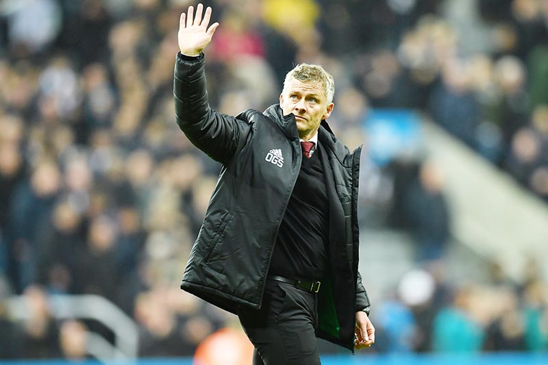 (FILES) In this file photo taken on October 06, 2019 Manchester United's Norwegian manager Ole Gunnar Solskjaer gestures to supporters on the pitch after the English Premier League football match between Newcastle United and Manchester United at St James's Park in Newcastle-upon-Tyne, north east England on October 6, 2019.	photo: AFP