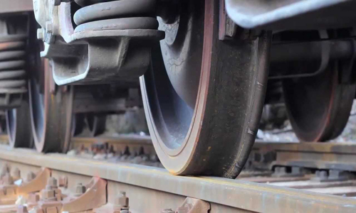 Woman crushed under train