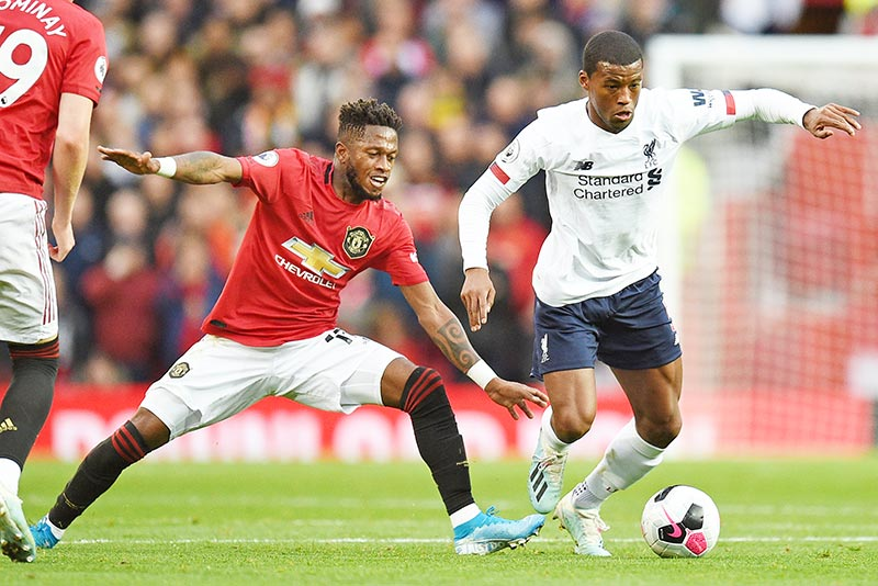 Manchester United's Brazilian midfielder Fred (L) vies with Liverpool's Dutch midfielder Georginio Wijnaldum (R) during the English Premier League football match between Manchester United and Liverpool at Old Trafford in Manchester, north west England, on October 20, 2019.	photo: AFP