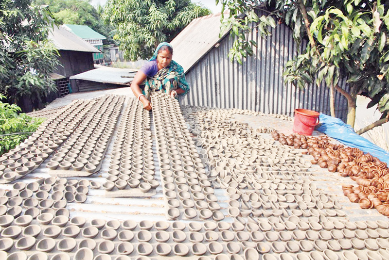 Pals are busy making earthen lamps ahead of Diwali festival