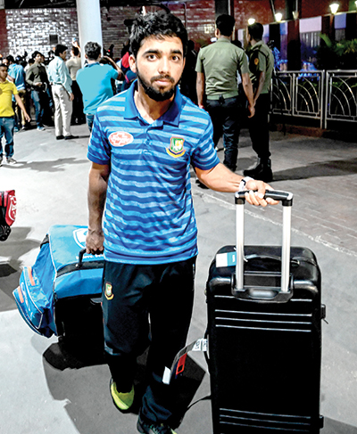 In this file photo taken on March 16, 2019 Bangladesh cricketer Mominul Haque is seen upon the team's arrival from New Zealand in Dhaka, a day after narrowly escaping the mosque attack that killed 49 people in Christchurch. - Bangladesh�s newly-appointed Test captain Mominul Haque said he was excited to get an opportunity to rub shoulder with India�s Virat Kohli during the forthcoming Test series between the two teams in India.photo: AFP