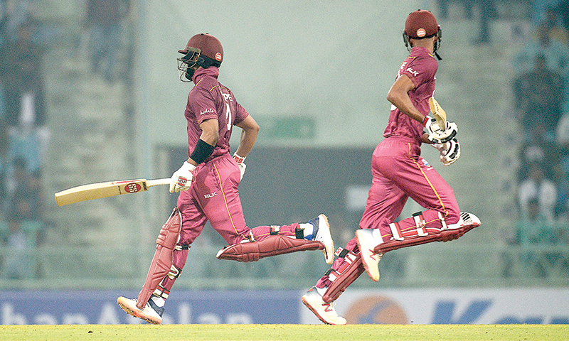 West Indies' Roston Chase (R) and West Indies' Shai Hope run between the wickets during the first one day international (ODI) cricket match between Afghanistan and West Indies at the Ekana Cricket Stadium in Lucknow on November 6, 2019.	photo: AFP