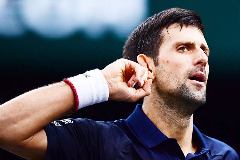 Serbia's Novak Djokovic reacts during his tennis match against Bulgaria's Grigor Dimitrov during their men's singles semi-final tennis match at the ATP World Tour Masters 1000 - Rolex Paris Masters - indoor tennis tournament at The AccorHotels Arena in Paris on November 2, 2019.	photo: AFP