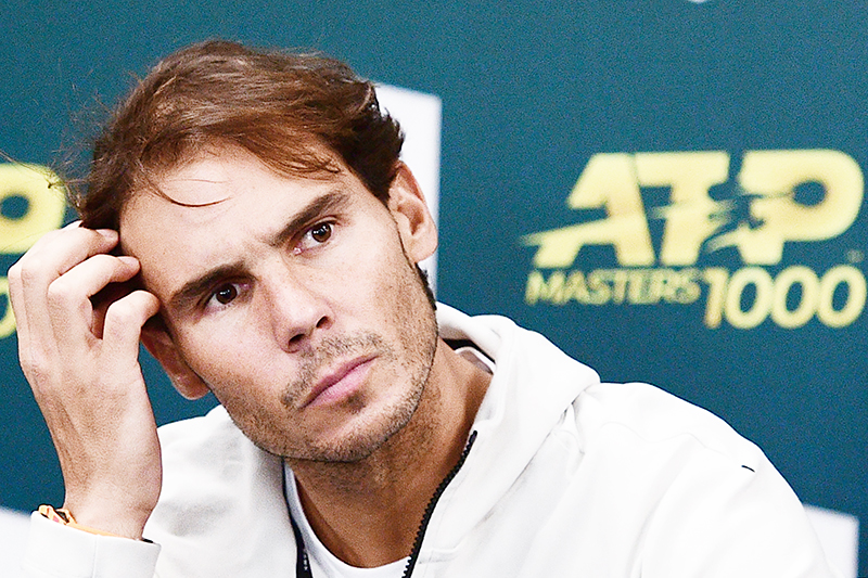 Spain's Rafael Nadal reacts as he addresses a press conference to announce his withdrawal from the men's singles semi-final tennis match and the ATP World Tour Masters 1000 - Rolex Paris Masters - indoor tennis tournament at The AccorHotels Arena in Paris on November 2, 2019.	photo: AFP