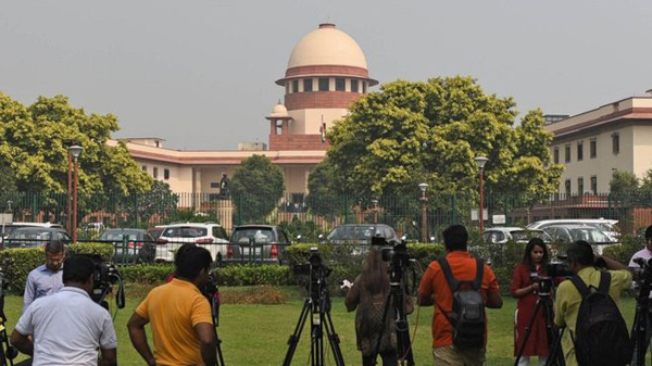 Indian media have gathered outside the Supreme Court in Delhi for the verdict