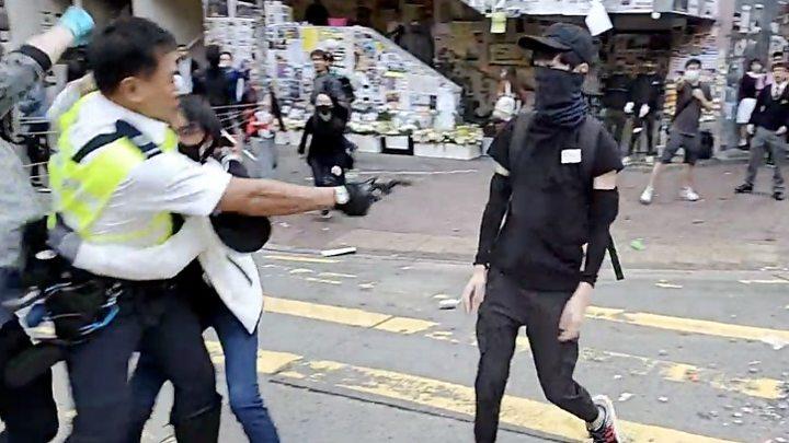 Hong Kong police shoot man in rush hour protests