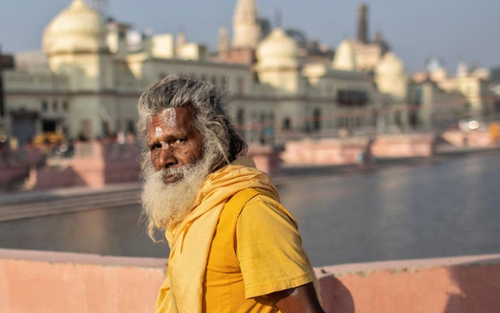 A Hindu priest leaves after performing prayers on the banks of Sarayu river after Supreme Court's verdict on a disputed religious site, in Ayodhya, India, Nov 11, 2019. REUTERS
