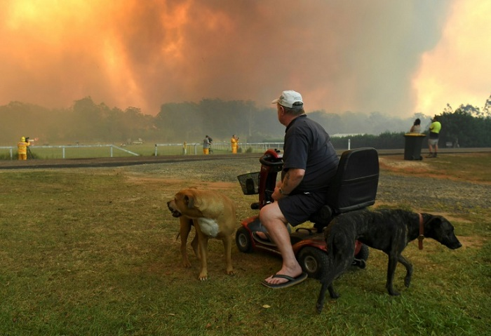 Thirteen of the more than 100 bushfires scarring the countryside were declared emergencies, with numerous towns under direct threat. AFP