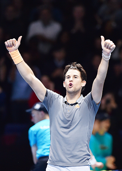 Austria's Dominic Thiem celebrates victory against Serbia's Novak Djokovic during their men's singles round-robin match on day three of the ATP World Tour Finals tennis tournament at the O2 Arena in London on November 12, 2019. Austria's Dominic Thiem beat Serbia's Novak Djokovic 6-7; 6-3; 7-6.photo: AFP