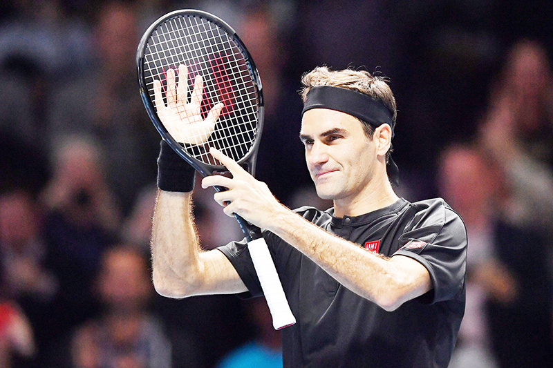 Switzerland's Roger Federer celebrates his straight sets win over Serbia's Novak Djokovic in their men's singles round-robin match on day five of the ATP World Tour Finals tennis tournament at the O2 Arena in London on November 14, 2019. Roger Federer beat Novak Djokovic 6-4, 6-3 to reach the last four at the ATP Finals on Thursday, a result that confirms Rafael Nadal will finish the year as world number one.photo: AFP