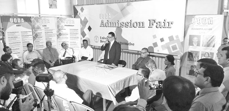 Founder of University of Alternative Prof Mujib Khan speaks at an admission fair for Honours and Masters programme on the campus on Sunday.	photo : observer