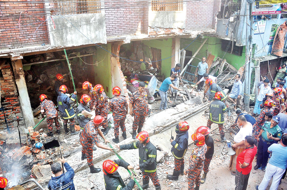 Fire fighters checking the debris at the spot where at least seven of a family were killed in a gas pipeline explosion in Pathorghata area of Chattogram on Sunday. PHOTO: OBSERVER