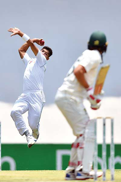 Pakistan's paceman Naseem Shah bowls to Australia's Joe Burns (R) on day two of the first Test cricket match between Pakistan and Australia at the Gabba in Brisbane on November 22, 2019. 	photo: AFP