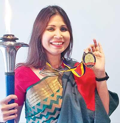 Nazmun awarded 'Peace Torch Award'