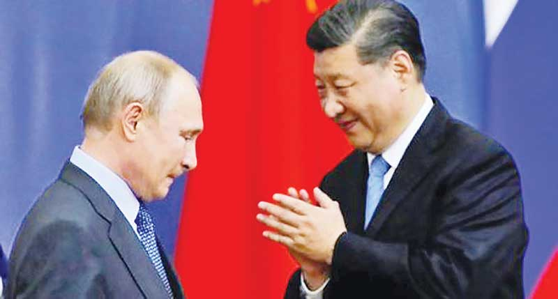 Russian President Vladimir Putin and Chinese leader Xi Jinping on Monday launched the first gas pipeline linking the two countries in Moscow.