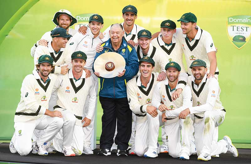 The Australian team celebrates with the trophy after Australia defeated Pakistan on the fourth day of the second cricket Test match in Adelaide on December 2, 2019.	photo: AFP