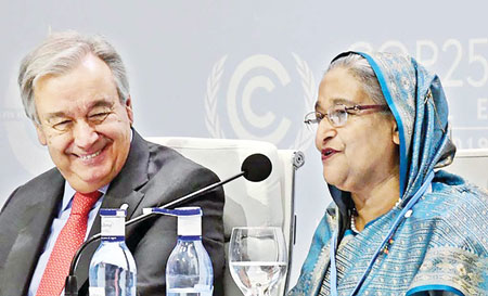 "Prime Minister Sheikh Hasina speaking on ""Action for Survival"" as the leader of one of the most vulnerable nations at the 2019 UN Climate Change Conference, known as COP25, while UN Secretary-General Antonio Guterres looks on in Madrid on Monday.	PHOTO: PID"