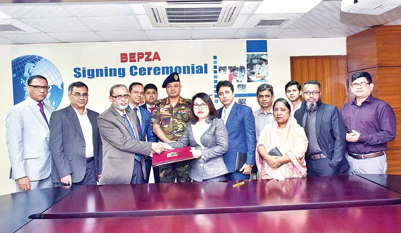 BEPZA Member (Investment Promotion) Zillur Rahman and Cherry Button Limited Chairman Ma Miaoyan exchanging documents after signing an agreement for their respective business organisations at BEPZA Complex in the capital recently.