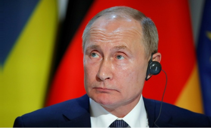 Putin slammed the decision as a 'politically motivated' ruling --POOL/AFP / CHARLES PLATIAU