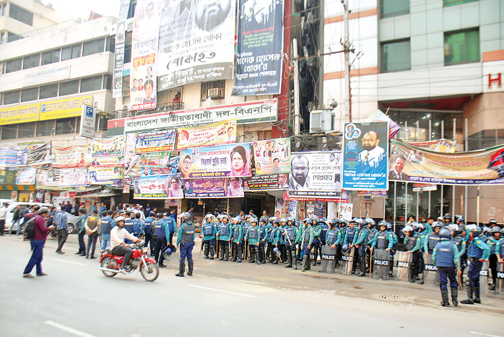 Additional police have been deployed in front of the BNP's Nayapaltan central office in the capital on Tuesday as the party was set to bring out a procession to observe the UN-declared International Human Rights Day.	photo : Observer