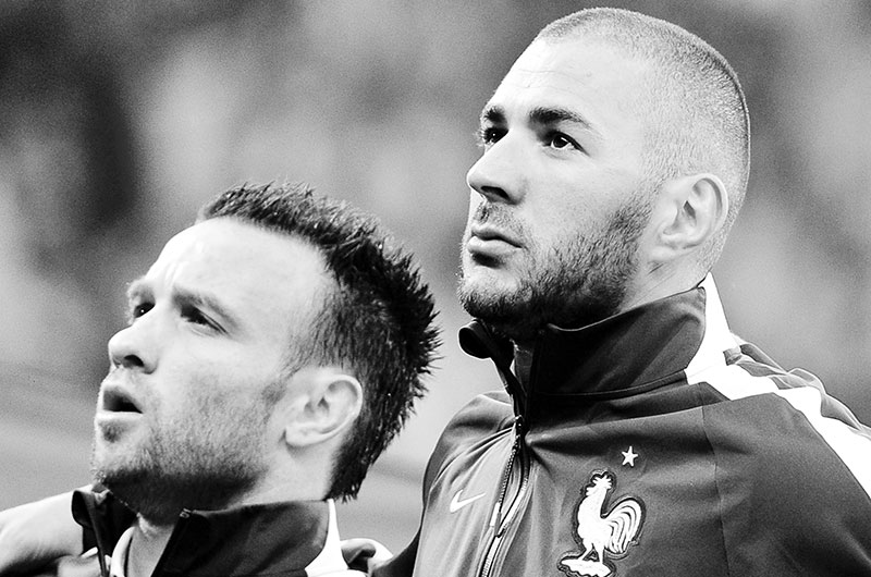 This file photo taken on June 8, 2014 shows France's midfielder Mathieu Valbuena (L) and France's forward Karim Benzema posing before the friendly football match between France and Jamaica at the Pierre-Mauroy stadium in Villeneuve-d'Ascq, northern France.	photo: AFP