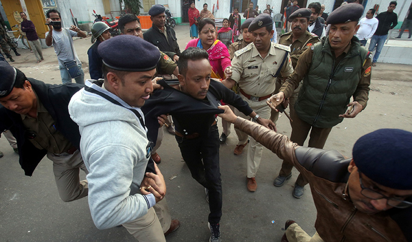 Policemen detain a demonstrator during a protest after India's parliament passed Citizenship Amendment Bill (CAB), in Agartala, India, December 12, 2019: Reuters