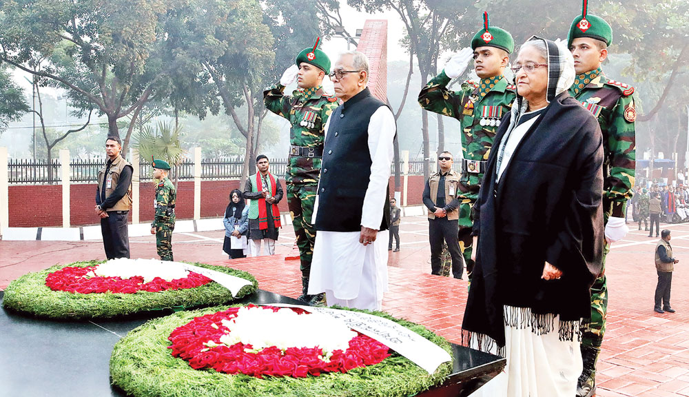 President Abdul Hamid and Prime Minister Sheikh Hasina standing in solemn silence for some time as a mark of  profound respect to the martyred intellectuals at the Martyred Intellectuals� Memorial at Mirpur in the capital on Saturday on the occasion of the Martyred Intellectuals� Day.PHOTO: BSS