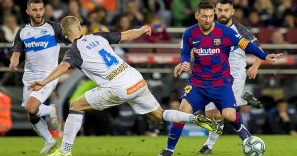 Messi closes year with 50 goals as Barcelona routs Alaves