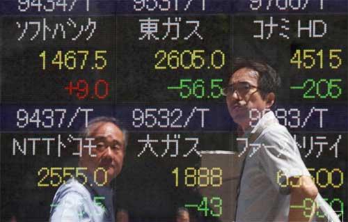 Asian shares slip