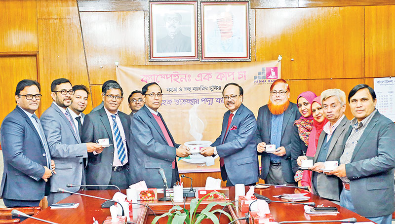 Padma Bank Managing Director and Chief Executive Officer Md Ehsan Khasru and Investment Corporation of Bangladesh Managing Director Md. Abul Hossain, flanked by senior officials of the two institutions formally inaugurate the 'One Cup Tea' Campaign at the ICB Head Office at Motijheel on Wednesday.