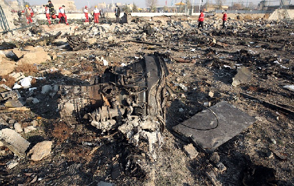 Rescue teams work at the scene after a Ukrainian plane carrying 176 passengers crashed: AFP
