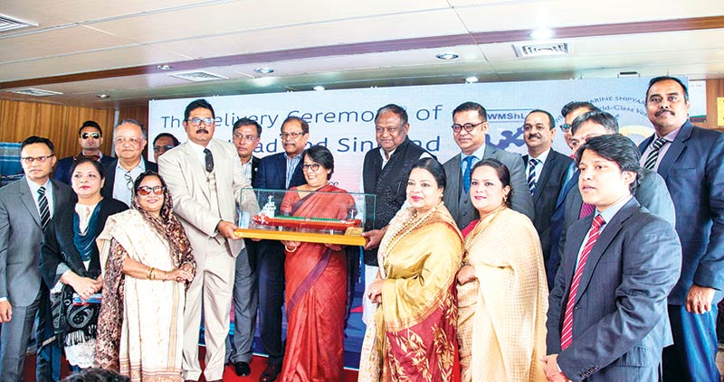Indian High Commissioner to Bangladesh Mrs. Riva Ganguly Das, Commerce Minister Tipu Munshi and WMS Chairman Md Saiful Islam, franked by other guests, holding a replica of a vessel, at a ship handing over ceremony at WMS in Chittagong on Friday.