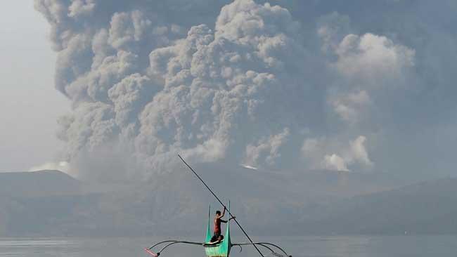 Philippines on alert as volcano spews ash, lava