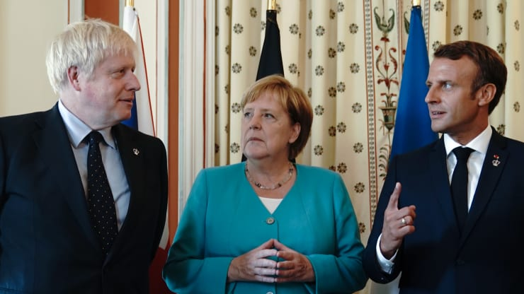 Chancellor Angela Merkel (CDU) stands between Boris Johnson (l), Prime Minister of Great Britain, and Emmanuel Macron, President of France, at the beginning of the summit. picture alliance