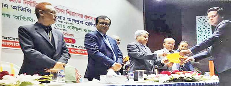 Md Abdul Halim, Secretary, Ministry of Industries hands over appointment letters to some 9th and 10th grade new officials of Bangladesh Chemical Industries Corporation at a programme on Tuesday.	photo: observer