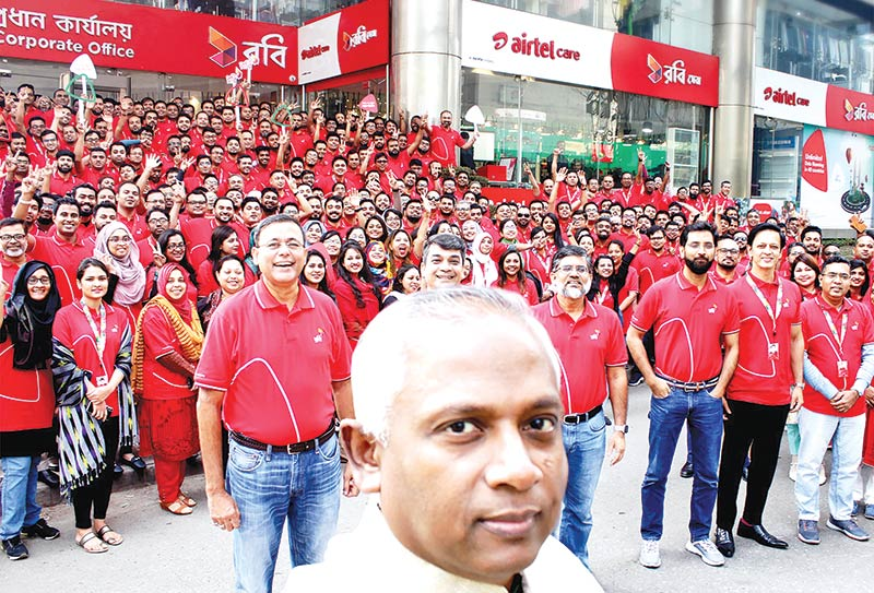 Robi Managing Director and CEO Mahtab Uddin Ahmed captures his workforce in a selfie at his company's head office in Dhaka.