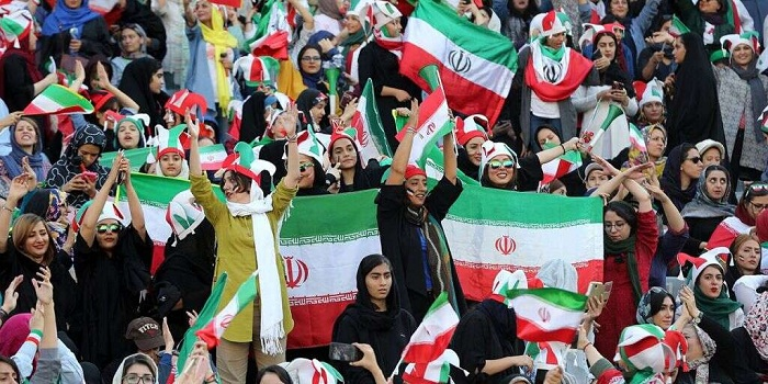 Iranian fans support their national football team during 2022 FIFA World Cup Asia qualifications Group C soccer match between Iran and Cambodia at Azadi Stadium in Tehran, Iran.  The Asian Football Confederation (AFC) has banned the country from hosting international matches. (Photo by Stringer /Anadolu Agency via Getty Images)