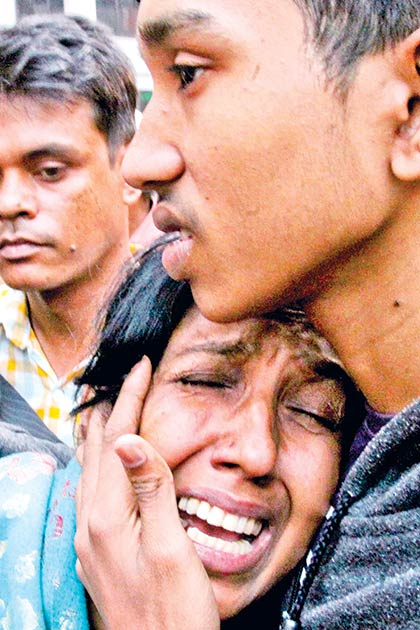 A woman breaks down in tears in front of DMCH hearing the death of her relative, Abu Bakkar Siddique Babu an official of the FDC, in police custody at Tejgaon Police Station in the capital on Sunday  PHOTO: OBSERVER