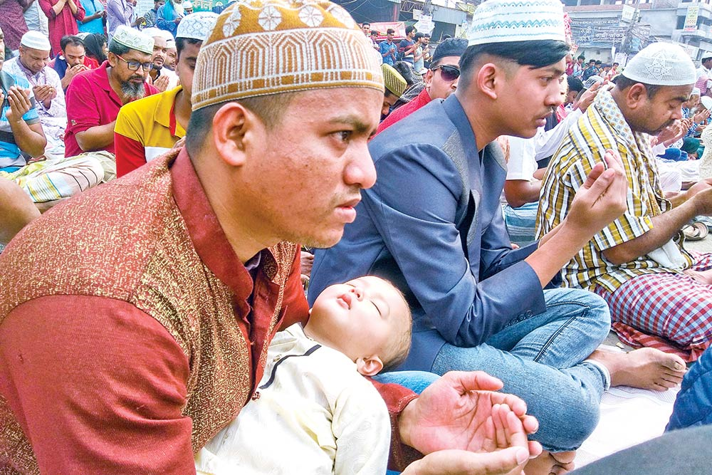 Devotees taking part in the Akheri Munajat or final prayer capping the 55th Bishwa Ijtema on the banks of the Turag River in Tongi on Sunday.PHOTO: OBSERVER
