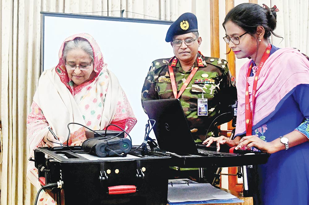 Department of Immigration and Passports taking photograph of Prime Minister Sheikh Hasina at her official residence Ganobhaban on Sunday for e-passport that will be introduced in the country on Wednesday. 	PHOTO: PID