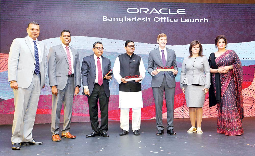 Finance Minister AHM Mustafa Kamal, MP (3rd from left), ICT State Minister  Zunaid Ahmed Palak (4th from left), US Ambassador to Bangladesh Earl R. Miller (3rd from right) and Oracle ASEAN Regional Managing Director Cherian Varghese (2nd from right), pose among others at the Oracle's celebration of 20 years in Bangladesh, at a city hotel on Thursday.