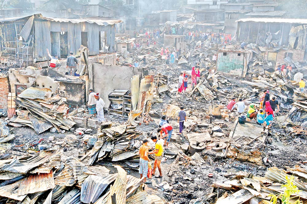Charred remains of Chalantika Slum in the capital's Mirpur after it was gutted in a fire on Friday.